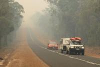 Bush fire   Car in the smoke of the fire